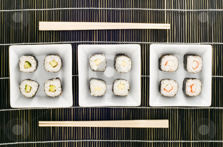 Sushi stock photo, Three plates with different kinds of sushi by Petr Koudelka