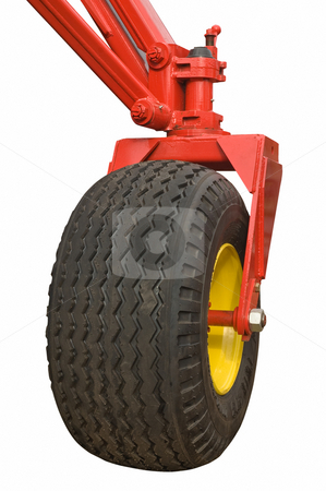 Agricultural machine wheel isolated stock photo, Agricultural machine wheel isolated on white background, clipping path. by Pablo Caridad