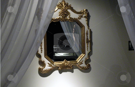 Lonely piano in the mirror stock photo, A mirror with the reflection of a lonely piano in it. by Rob Wright