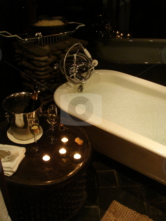 Bathtub stock photo, Closeup of a bathtub with two glasses of champagne by Johnny Griffin