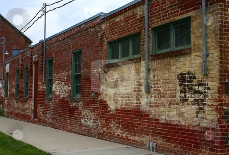 Old brick building with green-painted windows stock photo, Old brick building with green painted windows viewd to emphasize perspective by Wes Shepherd