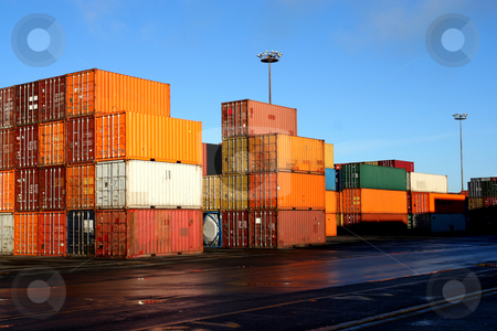 Containers in an intermodal yard stock photo, Containers waiting to be loaded in an intermodal yard by Claude Beaubien