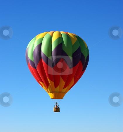 Hot Air Ballon And Clear Sky stock photo, A multi colored Hot Ait Ballon rises into a clear bright sky by Lynn Bendickson