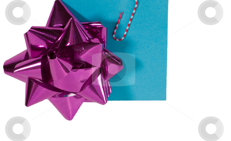 Holiday Bow on sticky note stock photo, Holiday Bow on sticky note with colorful paper clip by Robert Cabrera