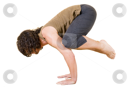 Yoga crane pose stock photo, Attractive young man in the yoga 'Crane pose - bakasana', isolated on white. by Nicolaas Traut