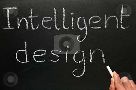 A teacher writing Intelligent Design on a blackboard. stock photo, A teacher writing Intelligent Design on a blackboard. by Stephen Rees