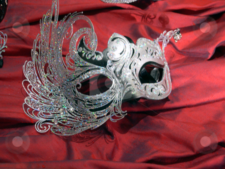 Elegant mask stock photo, An elegant mask atop red velvet by Rob Wright