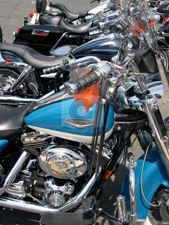 Row of motorcycles stock photo, Motorcycles lined up in a row. by Rob Wright