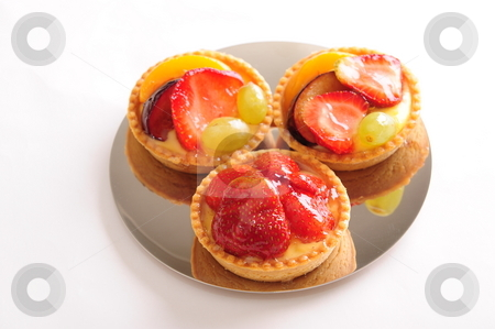Strawberry custard pastry stock photo, Delicious freshly baked strawberry custard fruit pastry on a shiny plate.  White background, not isolated. by Nicolaas Traut
