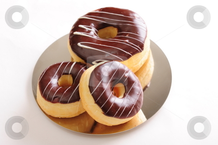 Fresh chocolate donuts stock photo, Freshly baked delicious chocolate donuts on a shiny plate.  White background, not isolated. by Nicolaas Traut