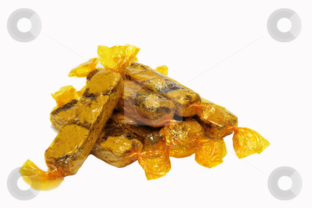Oatmeal bars stock photo, Oatmeal bar cookies individually wrapped in yellow cellophane by Jonas Marcos San Luis
