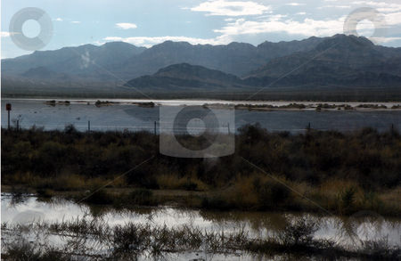 Mountains reflected stock photo, Fresh rain fall in the dessert reflecting the mountains in the background by Rob Wright