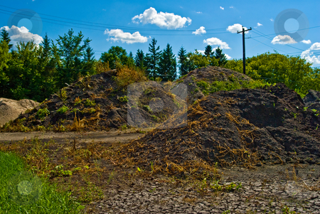 Soil Mounds stock photo, Large hills of soil for gardening purposes by Richard Nelson