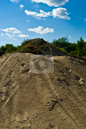 Gravel Hill stock photo, Industrial hills of gravel and soil used for excavation purposes by Richard Nelson