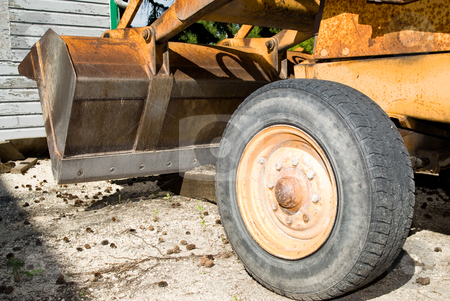 Tractor stock photo, Closeup view of a bucket on a tractor by Richard Nelson