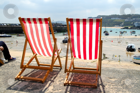 Two empty deckchairs on the sea front, St. Ives, UK. stock photo, Two empty deckchairs on the sea front, St. Ives, UK. by Stephen Rees