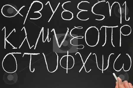 A teacher writing the Greek alphabet on a blackboard. stock photo, A teacher writing the Greek alphabet on a blackboard. by Stephen Rees