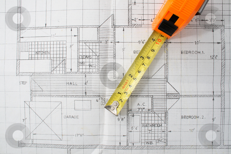 A measuring tape on top of house plans. stock photo, A measuring tape on top of house plans. by Stephen Rees