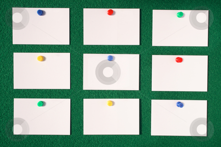 White blank business/advertisement cards. stock photo, White blank business/advertisement cards pinned to a green felt notice board. by Stephen Rees