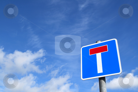 A British no through road T sign and a blue sky. stock photo, A British no through road T sign and a blue sky. by Stephen Rees