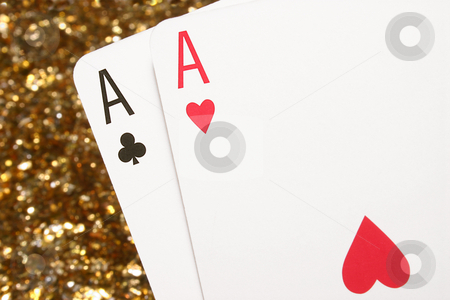 Pair of Aces stock photo, A pair of aces with a glittering gold background. by Stephen Rees