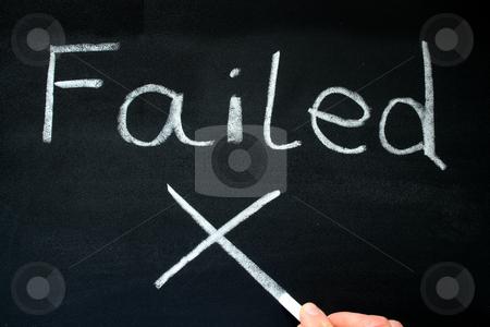 A teacher writing failed on a blackboard. stock photo, A teacher writing failed on a blackboard. by Stephen Rees