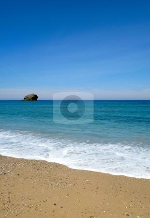 Gull rock island, the beach, blue summer sky and sea in Portreath, Cornwall UK. stock photo, Gull rock island, the beach, blue summer sky and sea in Portreath, Cornwall UK. by Stephen Rees