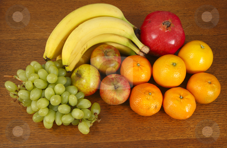 Fruit selection. stock photo, Fruit selection.  Bananas, grapes, oranges, apples, tangerines and a red pomegranate. by Stephen Rees