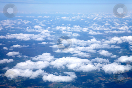 Flying above white clouds over Ireland. stock photo, View from an aeroplane window, flying above white clouds over Ireland. by Stephen Rees