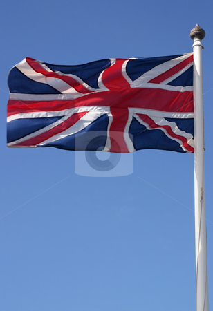 The Union flag (Union Jack) blowing in the wind on a sunny day stock photo, The Union flag (Union Jack) blowing in the wind on a sunny day by Stephen Rees