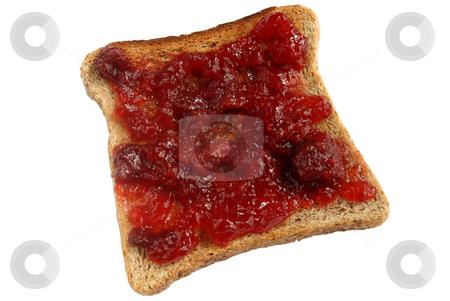 Strawberry jam spread on toast. stock photo, Strawberry jam spread on toast. by Stephen Rees
