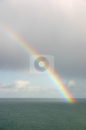 Vertical view of a natural rainbow over the sea stock photo, Vertical view of a natural rainbow over the sea, St. Ives, Cornwall. by Stephen Rees