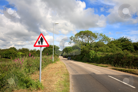 Country road and pedestrians in road sign, Cornwall, UK. stock photo, Country road and pedestrians in road sign, Cornwall, UK. by Stephen Rees