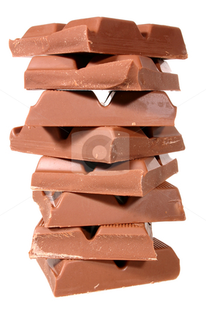 A pile of chocolate isolated on a white background. stock photo, A pile of chocolate isolated on a white background. by Stephen Rees