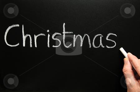 Writing Christmas on a blackboard. stock photo, Writing Christmas on a blackboard. by Stephen Rees