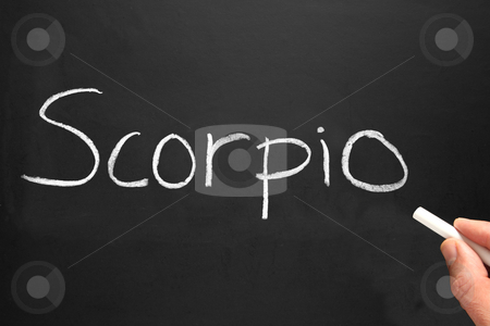 The star sign Scorpio written on a blackboard. stock photo, The star sign Scorpio written on a blackboard. by Stephen Rees