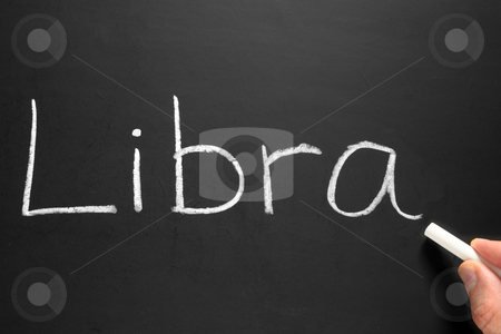 The star sign Libra written on a blackboard. stock photo, The star sign Libra written on a blackboard. by Stephen Rees