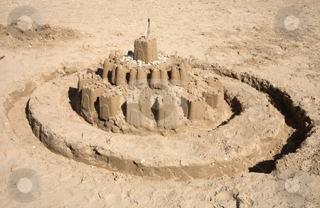 A sandcastle and moat on the beach. stock photo, A sandcastle and moat on the beach. by Stephen Rees