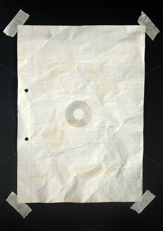 An old piece of A4 lined paper. stock photo, An old piece of A4 lined paper stuck with masking tape to a blackboard. by Stephen Rees