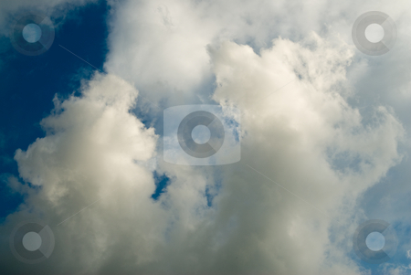 Clouds Background stock photo, A background of white fluffy clouds, shot against a blue sky by Richard Nelson
