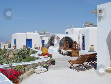Traditional house mykonos stock photo, Traditional house with beatifull view at mykonos island cyclades greece travel destinations by EVANGELOS THOMAIDIS