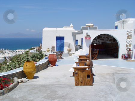 Traditional house mykonos stock photo, Traditional house with view  at mykonos  island cyclades greece travel destinations by EVANGELOS THOMAIDIS