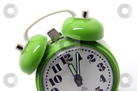 Green alarm clock stock photo, Small green alarm clock at twelve oclock isolated on white background by EVANGELOS THOMAIDIS