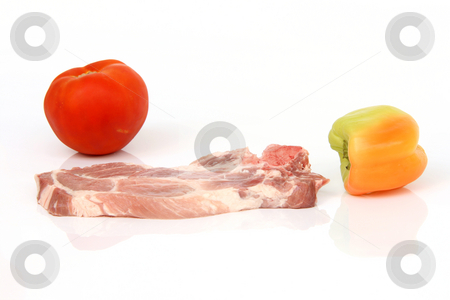 Vegetables and meat stock photo, Raw pork chop tomatoe and pepper isolated on white background with reflection and copy space by EVANGELOS THOMAIDIS