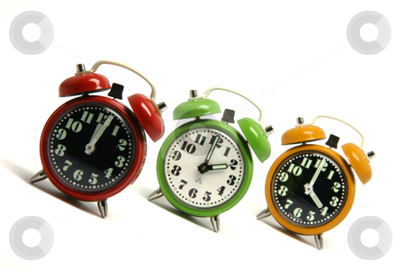 Time passing stock photo, Three classic small alarm clocks isolated on white background by EVANGELOS THOMAIDIS