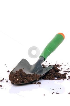 Shovel and soil stock photo, Garden tools shovel and soil on white background by EVANGELOS THOMAIDIS