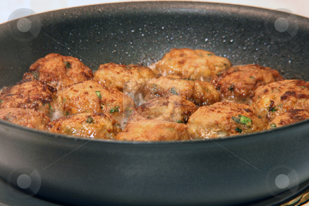 Meat balls frying stock photo, Cooking meat balls in frying pan food concepts by EVANGELOS THOMAIDIS