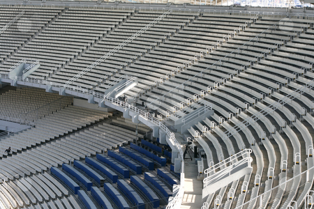 Stadium tiers stock photo, Athens olympic stadium detail seats tiers and broadcasting camera by EVANGELOS THOMAIDIS