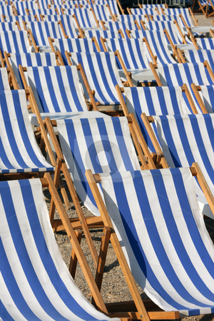 Chaise longues texture stock photo, Blue; white; chaise longue; texture; tables; summer; concepts; background; wooden; wood; fabric; objects; pattern; sunny; reclining; chair; lengthened; seat; forming; rest; large; chair; group, relax, beach, holidays by EVANGELOS THOMAIDIS
