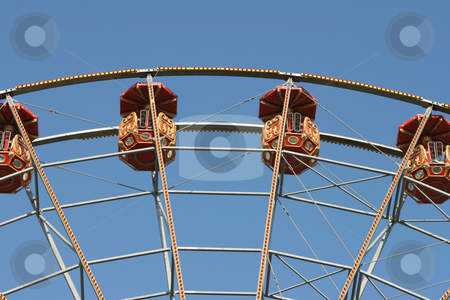 Ferris wheel baskets stock photo, Detail from big ferris wheel baskets at amusement park and blue sky by EVANGELOS THOMAIDIS